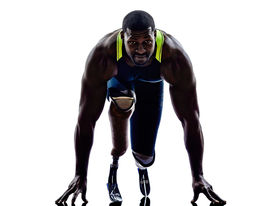 stock photo of sprinters  - one muscular handicapped man runners sprinters  with legs prosthesis in silhouettes on white background - JPG