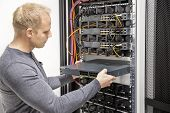 IT consultant builds network racks in data center