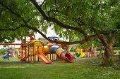 picture of playground  - empty children urban playground green park view - JPG