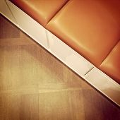 Leather Bench On Wooden Floor