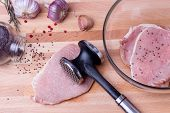 foto of food preparation tools equipment  - Raw pork schnitzel - JPG