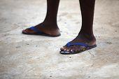 Feet Of An African Man In Blue Flip Flops