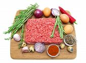 Minced Meat Of Beef And Different Foods On White Background