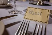 image of wedding feast  - Priest seat at a table at wedding reception - JPG