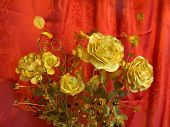Golden roses on red background