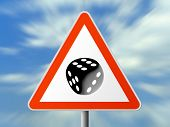 Triangle sign with dice (six), sky background