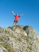 Man on the top of mountain - happiness and success