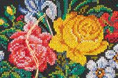 Roses and needle with thread - embroidery (closeup)