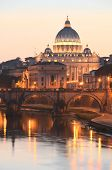 Picturesque landscape of St. Peters Basilica over Tiber  at sunset in Rome, Italy