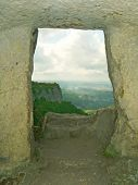 Window in stony wall, cave town, Crimea
