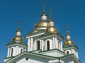 Gold crosses and domes of church, blue sky