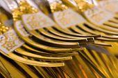 Macro of golden forks, food background