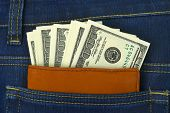 Money and wallet in jeans pocket, shopping background
