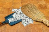 Money and broom, business concept