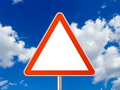 Triangle traffic sign, sky on background