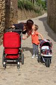Mother and daughter with prams