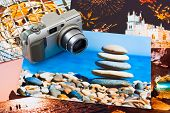 Camera and photo printouts (my photos), travel background