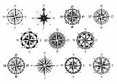 foto of wind-rose  - Vector antique compasses with ornate dials for use as design elements in vintage or retro nautical and marine concepts - JPG