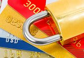 Credit cards and lock - business security background