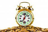 Alarm clock and money isolated on white background