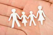 Paper family in hand - home concept