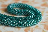 Knitted Necklace Of Color Aquamarine From Beads Close Up