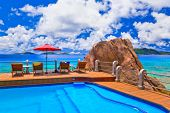 Pool at tropical beach - vacation background