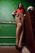 Woman In Vintage Room With Exagerated Legs