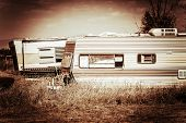 stock photo of trailer park  - Old Rusty Campers in Some Rural American Area - JPG