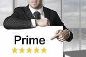 Businessman Pointing On Sign Prime