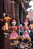 stock photo of nepali  - Souvenir puppets hanging in the shop of Thamel Kathmandu Nepal - JPG