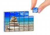 Hand and seascape (my photo) puzzle isolated on white background