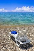 Chair at greek beach - vacations background