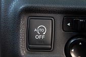 stop-start system button