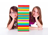 Two Girls Next To Book Column