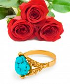 Roses and golden ring isolated on white background