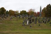 An Old Historic Graveyard With Fall Foliage