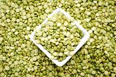 Background Of Split Peas In A White Square Bowl