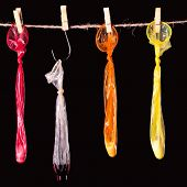 Condoms hanging on a rope