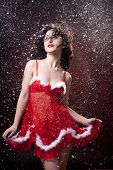 Sexy Santa helper. Red dress. Snowing