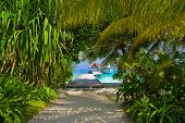 Pathway to jetty and moored yacht - vacation background