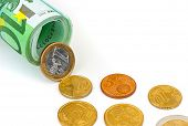 Euro coins and banknotes isolated on white background