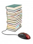 Computer mouse and books isolated on white background