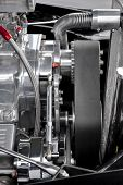 stock photo of dragster  - drive belt and parts on a performance car engine - JPG