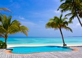 Pool on a tropical beach, vacation background