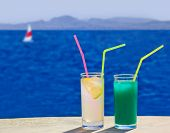 Two cocktails on table at beach - travel background