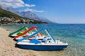 Multicolored catamaran on beach at Croatia - vacations background