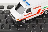 Computer keyboard and medical car - technology background