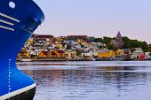 Ship and cityscape of Kristiansund Norway - travel background