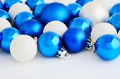 Blue And White Christmas Balls On The White Background